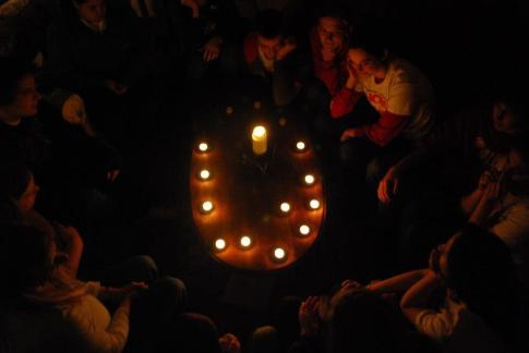 the circle of light at house party with our juniors and seniors...the bittersweet moment of endings.